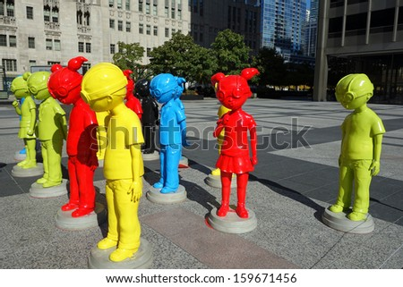 "CHICAGO, ILLINOIS/USA-OCTOBER 9:  On October 9, 2013, ""The Watch"" a collection of 16 brightly-colored goggle-wearing child super hero figures went on display in Pioneer Court Plaza in Chicago."
