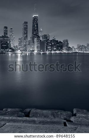 Chicago. Image of Chicago skyline and Lake Michigan coastline at night.