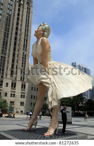 CHICAGO - JULY:  A giant 26 foot tall sculpture of Marilyn Monroe was unveiled in Chicago on July 18, 2011.  Created by artist Seward Johnson, the work stands in a square on Michigan Avenue.