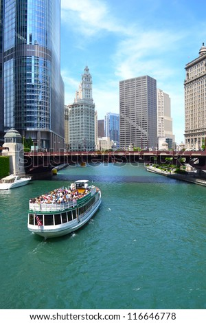 CHICAGO - JUNE 14: Chicago's First Lady, a Chicago River cruise boat, travels towards Lake Michigan during a 75-minute guided architectural tour on June 14, 2011. Chicago