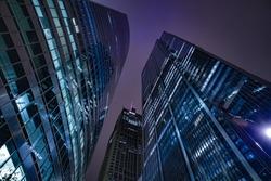 Chicago night life. Chicago illuminated skyline view at dusk, United States.  Bottom up view