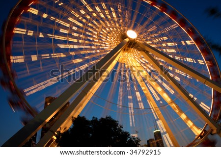 Chicago's Navy Pier amusement park at night with lighted Ferris Wheel