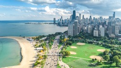 Chicago skyline aerial drone view from above, lake Michigan and city of Chicago downtown skyscrapers cityscape from Lincoln park, Illinois, USA