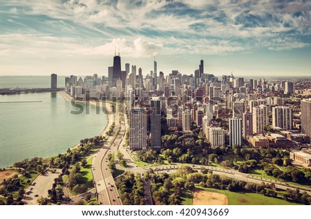 Chicago Skyline aerial view with road by the beach, vintage colors