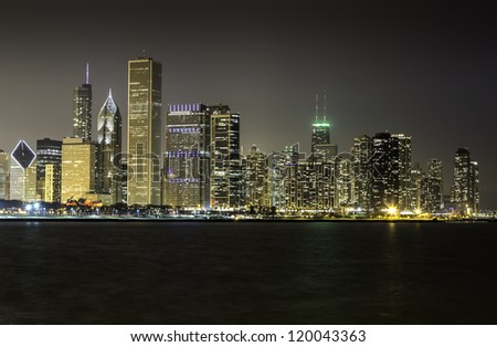 Chicago skyline at night illuminated by financial buildings