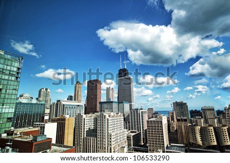 Chicago skyline on sunny blue sky day with clouds
