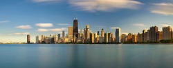 Chicago skyline panorama across Lake Michigan at sunset viewed from North Avenue Beach. Long exposure.