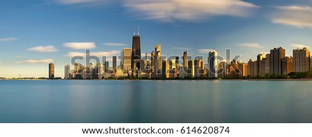 Stock Photo Chicago skyline panorama across Lake Michigan at sunset viewed from North Avenue Beach. Long exposure.