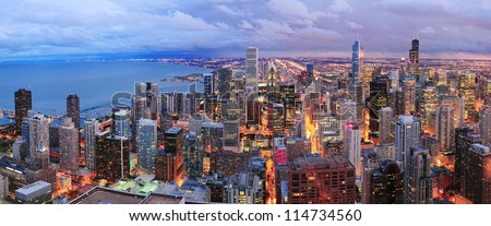 Stock Photo Chicago skyline panorama aerial view with skyscrapers over Lake Michigan with cloudy  sky at dusk.