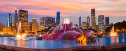Chicago skyline panorama with skyscrapers and Buckingham fountain at twilight.