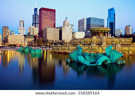 Chicago skyline reflected in Buckingham Fountain. Chicago, Illinois, USA.