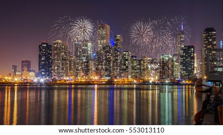 Chicago skyline with Reflection from Lake Michigan with Fireworks #553013110