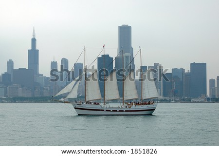 Chicago Skyline with Sailboat on a cloudy day