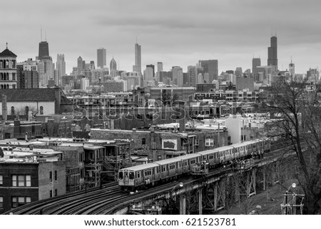 Chicago train passing through neighborhood with skyline in background