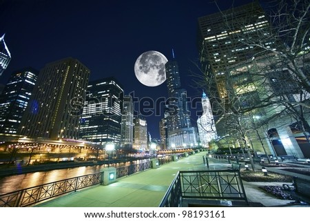 Chicago USA. Chicago at Night. Shot Taken from Chicago Famous Riverwalk. Large Moon on the Sky.