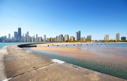 Chicago waterfront skyline seen from Lake Michigan pier on a beautiful day, USA.
