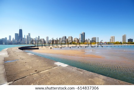 Chicago waterfront skyline seen from Lake Michigan pier on a beautiful day, USA. #614837306