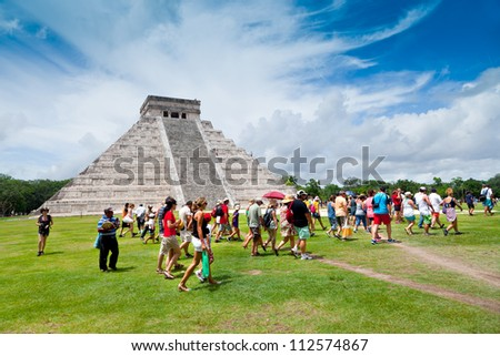 CHICHEN ITZA, MEXICO - AUGUST 15: Tourists visiting Chichen Itza, one of the new 7 wonders of the world thanks to the votes of millions of people worldwide on August 15, 2012 in Chichen Itza, Mexico