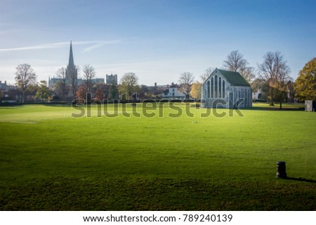 Chichester Guildhall, an ecclesiastical building in Priory Park Chichester, West Sussex, England, With Chichester cathedral spire in the distance