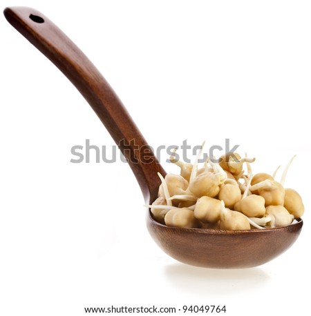 Chick peas over wooden spoon isolated on white