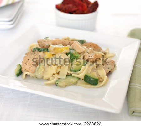 Chicken Alfredo pasta on the dinner table