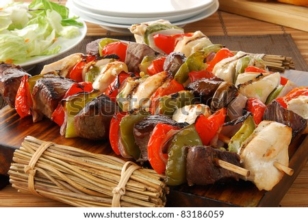 chicken and beef shish kebabs on a serving tray
