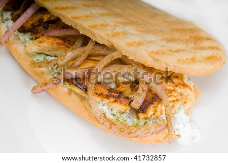 chicken and onion grilled panini sandwich close up on a plate