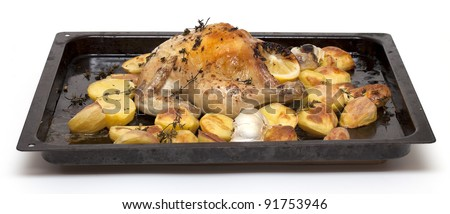 chicken and potatoes roasted with herbs and lemon