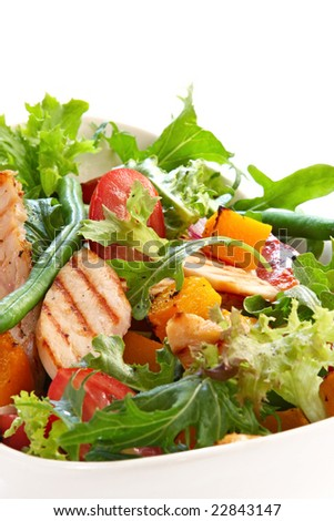 Chicken and roasted vegetable salad, with mixed greens.  Delicious healthy eating. - stock photo