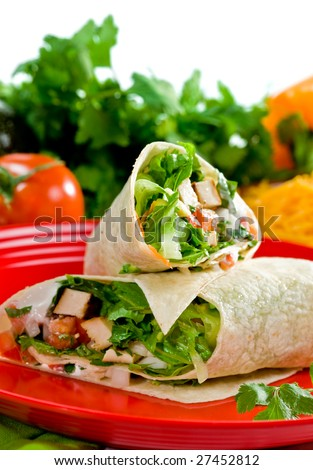 Chicken and vegetable fajitas in tortillas Mexican style - stock photo