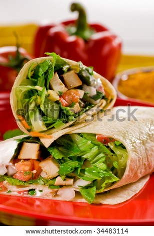 Chicken and vegetable fajitas in tortillas Mexican style