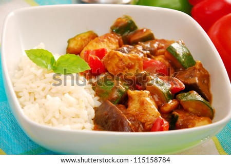 chicken and vegetables in curry sauce with rice for delicious dinner