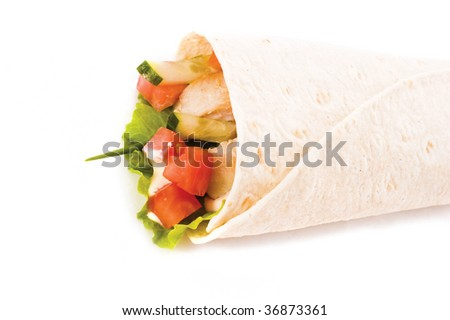 chicken and vegetables wrapped in a tortilla