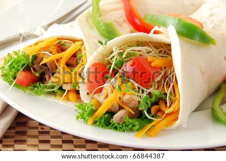 Chicken and vegetables wrapped in tortilla shells