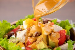 Chicken, avocado and tomato Cobb salad on the table