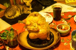 Chicken, baked in rosemary, with lychee, arugula, homemade plum wine. It melts in the mouth and is eaten very quickly.