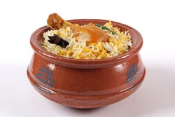 Chicken biryani in handi, Indian food, Delicious ramadan iftar meal, Pakistani spicy fried rice. Popular asian lunch, Haandi biryani.