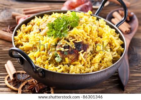chicken biryani in small wok