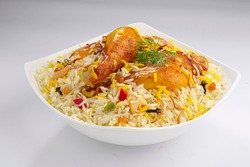 Chicken biryani , kerala style chicken dhum biriyani made using jeera rice and spices arranged in a white ceramic table ware with white background, isolated