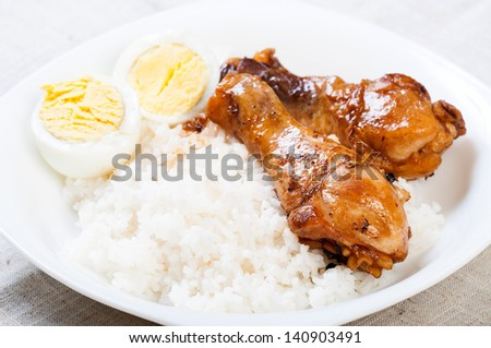 chicken braised in soy sauce, vinegar pepper and bay leaves/chicken adobo with eggs