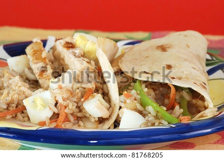 Chicken breast fried in smoky flavor of chipotle spices and wrapped in flour tortilla with rice, peppers, egg, vegetables, onions, carrot and special chipotle spread.