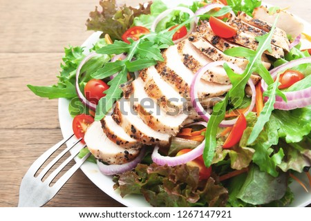 Chicken breast salad, Close up and selective focus on rocket salad. Healthy food