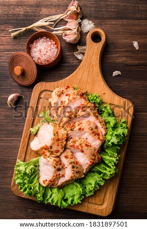 chicken breast sous-vide, Sous Vide chicken fillet on green lettuce leaves top view, flat lay Photo stock ©