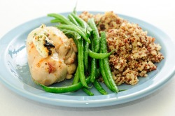 chicken breast stuffed with goat cheese and arugula, with french beans and quinoa