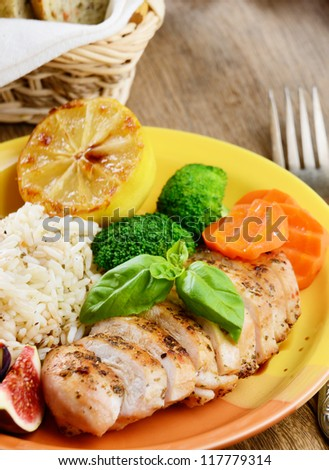 Chicken breast with rice, vegetables and fried pear