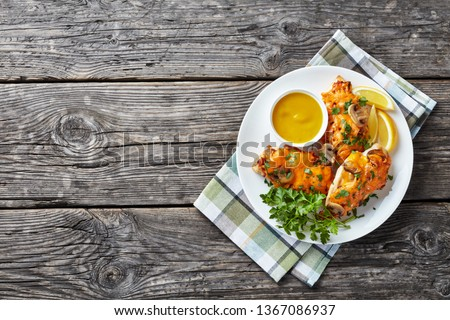 chicken breasts topped with mushrooms, bacon and cheddar cheese cooked in a honey-mustard sauce, view from above, copy space, flatlay