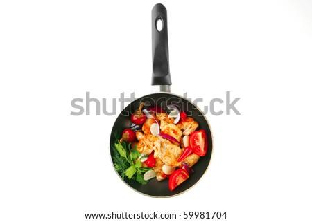 chicken brisket slices on a black pan