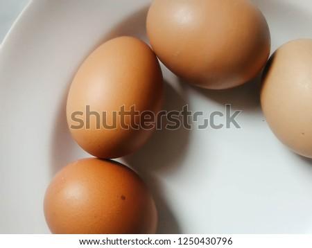 chicken brown eggs on dish, raw brown eggs, fresh eggs   #1250430796