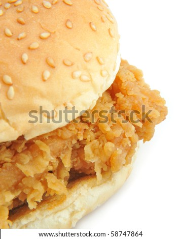 chicken burger on a sesame seed bun.