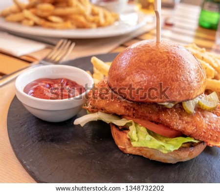 Close-up of a fresh crispy chicken burger on a plate Images